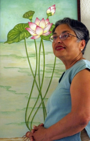 "Artist Jyotsna Raj poses with her painting ""Buddha's Lotus"""